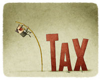 Jump over a tax Stock Photo