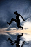 Jump over water. Jump over the water (abstract Royalty Free Stock Photos