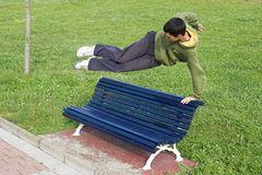 Jump parkour. Parkour , teenager jumping over a seat park Royalty Free Stock Images