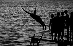 The jump. Photo taken at the danube, a group of children werw jumping in the water Royalty Free Stock Photo