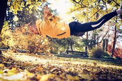 Jump pushups in nature. Young man. Stock Photo