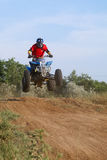 Jump on quad bike Stock Photo