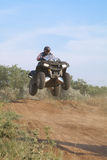 Jump on quad bike. Jump sportsman on quad bike Saki Crimea, Ukraine - June 19, 2011, the regional competition in motocross royalty free stock image