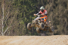 Jump with quad motorbike Royalty Free Stock Image