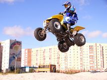 Jump on quadrocycle. Stock Images