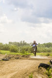 Jump rider on motocross. Stock Images