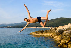 Jump from rock Royalty Free Stock Photo