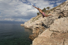 Jump from the rocks in Adriatic sea Royalty Free Stock Images