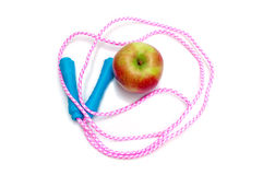 Jump rope and apple Stock Photo