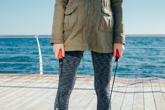 Jump rope in female hands closeup. On sea background Stock Photography