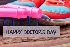 Jump rope, shoes and card. Stock Photography