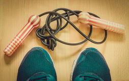 Jump rope and sneakers. Consider from above Stock Photography