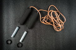 Jump rope with weights on yoga mat Stock Photography