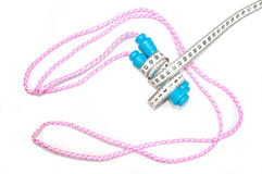 Jump rope wrapped with centimeter Stock Image