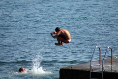 Jump in the sea Stock Photography