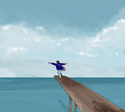 Jump into sea. Clothed man jumping off jetty into the sea Stock Photos