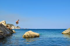 Jump into the sea. Jumping into the sea. Funny beach entertainment on a beautiful beach stock photography