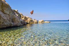 Jump into the sea. Jumping into the sea. Funny beach entertainment on a beautiful beach stock image