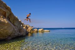 Jump into the sea. Jumping into the sea. Funny beach entertainment on a beautiful beach stock images