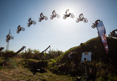 Jump sequence of FMX rider performing trick Royalty Free Stock Photos