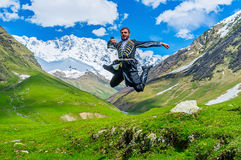 The jump at the Shkhara foot Royalty Free Stock Image
