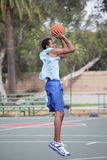Jump shot. Image of a basketball player making the jump shot Stock Image