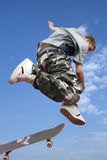 Jump on Skate. A Boy makes a jump with skateboard Royalty Free Stock Image