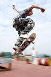 Jump on Skate. A Boy make a jum with skateboard Stock Photography