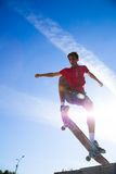 Jump on skateboard. Cool skateboard is jumping high in air Royalty Free Stock Photos