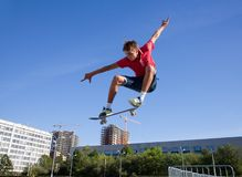 Jump on skateboard. Cool skateboard is jumping high in air royalty free stock image