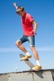 Jump on a skateboard. Cool skateboard is jumping high in air Stock Photos