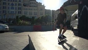 Jump of skateboarder in slow-mo. Skater in the city street. How to make ollie. Extreme sport and adrenaline stock video