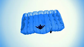 Jump from sky. Parachuter is few moment from a ground Stock Photography