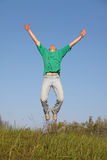 Jump in sky. Man in t-shirt Royalty Free Stock Photo