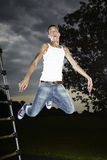 Jump of slim man Stock Photography