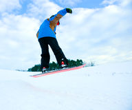 Jump with the snowboard. Boy is jumping with the snowboard stock image