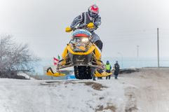 Jump of sportsman on snowmobile Stock Photography