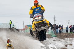 Jump of sportsman on snowmobile Royalty Free Stock Image