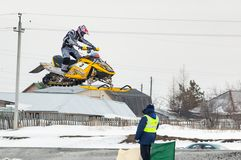Jump of sportsman on snowmobile Royalty Free Stock Photos