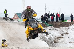 Jump of sportsman on snowmobile Royalty Free Stock Photography