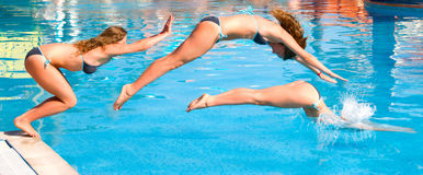 Jump to a pool. Woman jumps to a pool Stock Image