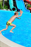Jump to pool. Funny slim boy jumping to the pool Stock Images