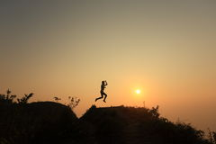 Jump on the top mountain Stock Photos