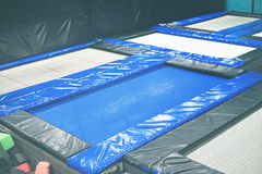 Jump Trampoline Urban Playground Adults Children. Jump Trampoline Blue Urban Playground for Adults and Children Large Scale Indoor Toned stock photo