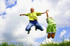 Jump of two people Stock Photos