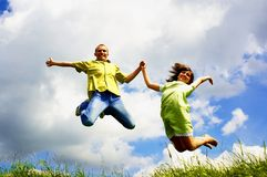 Jump of two people Royalty Free Stock Photo