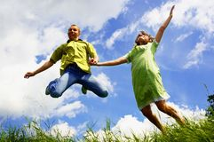 Jump of two people Stock Image