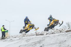 Jump of two sportsmen on snowmobile Royalty Free Stock Photos