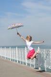 Jump with umbrella Stock Photo
