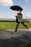 Jump with umbrella Royalty Free Stock Photo
